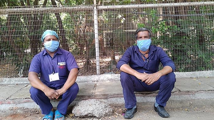 Ravindra Chavan (left) and Raju Chavan. They work as morgue assistants.