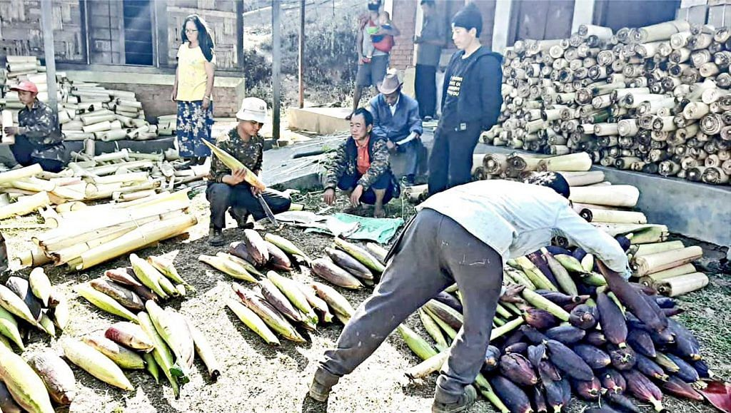 Villagers from Konsakhul readying vegetables to be supplied for free to villages in the plains.