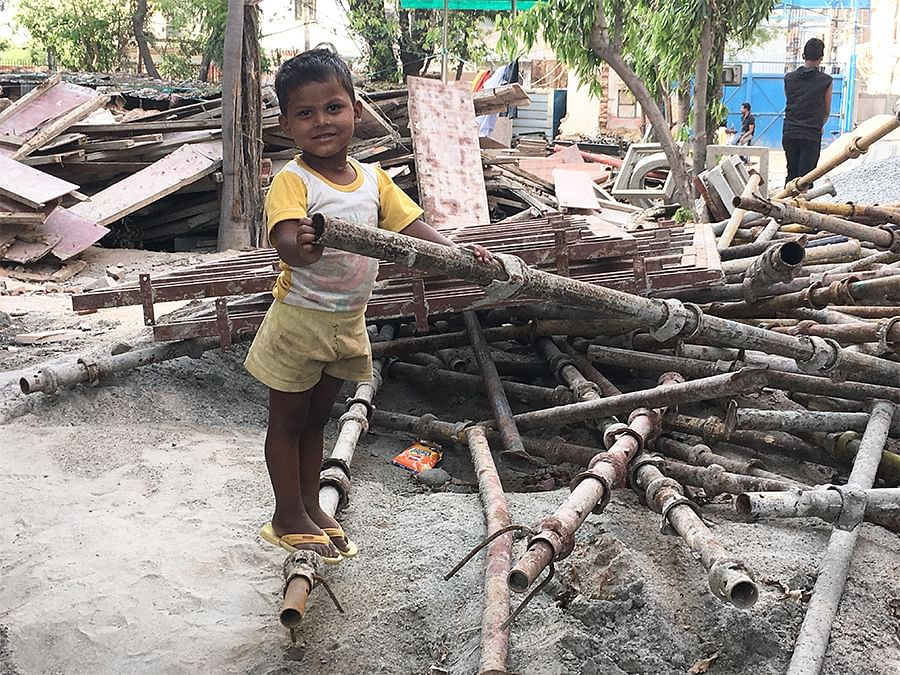 Afroz's parents work on a construction site for a school in Nangloi. He lives on the site and hasn't gone to school in six months.