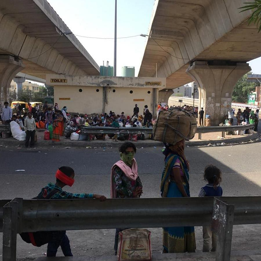 Migrants huddled under the overbridge in Badarpur.