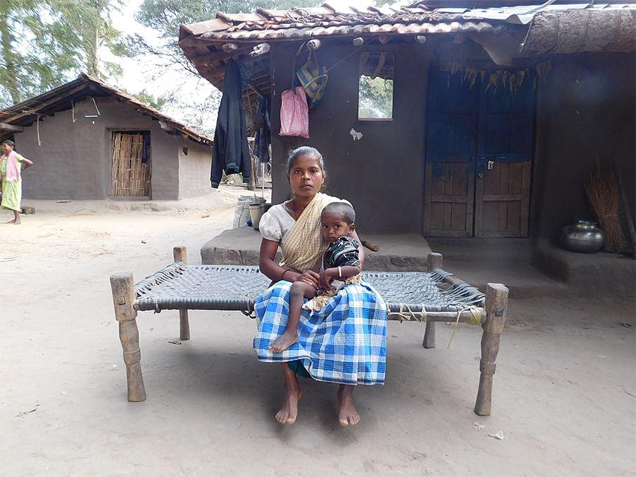 Kudum Badri with her child in Tadmetla.