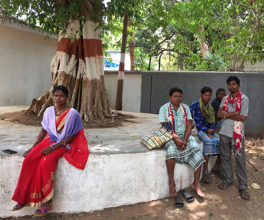 Adivasis wait for their jailed family members to be brought to the Dantewada court.