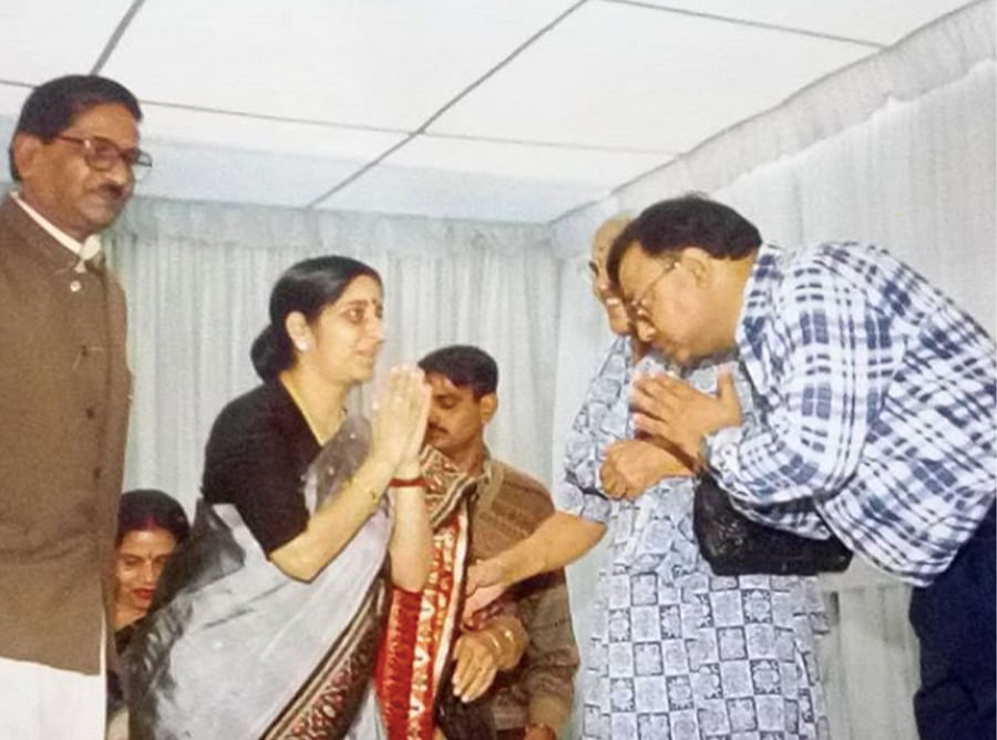 Gupta with Sushma Swaraj in an undated picture.