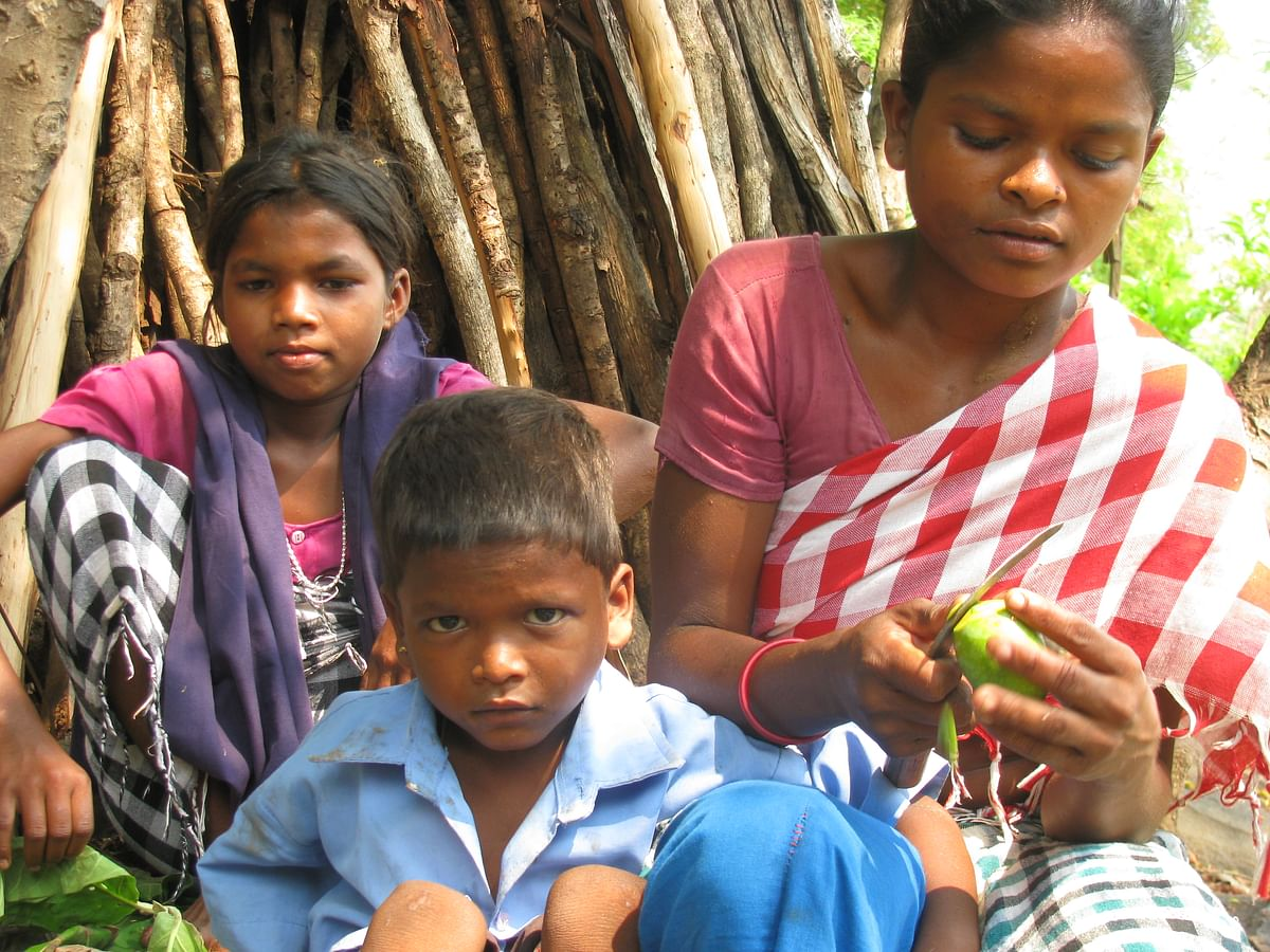 Bhima Kadati's wife, son and sister at their home in Phulpad village.