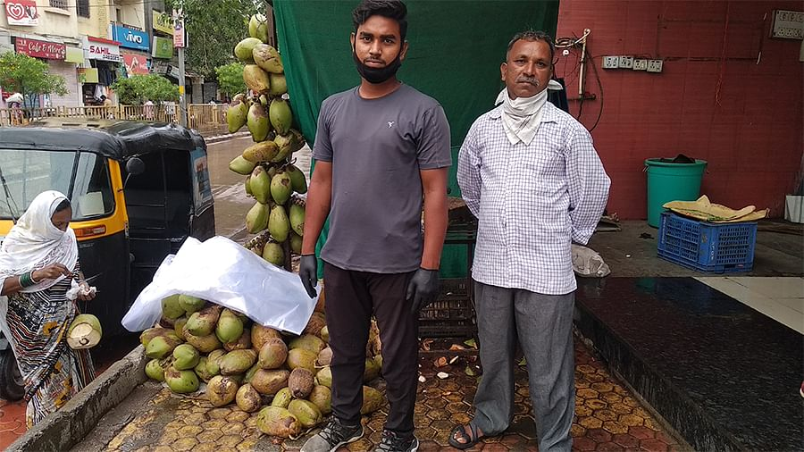Coconut seller Sanjit Ravidas (left) and Sunil Pagare, a waiter. Both have been struggling since the lockdown began in March.