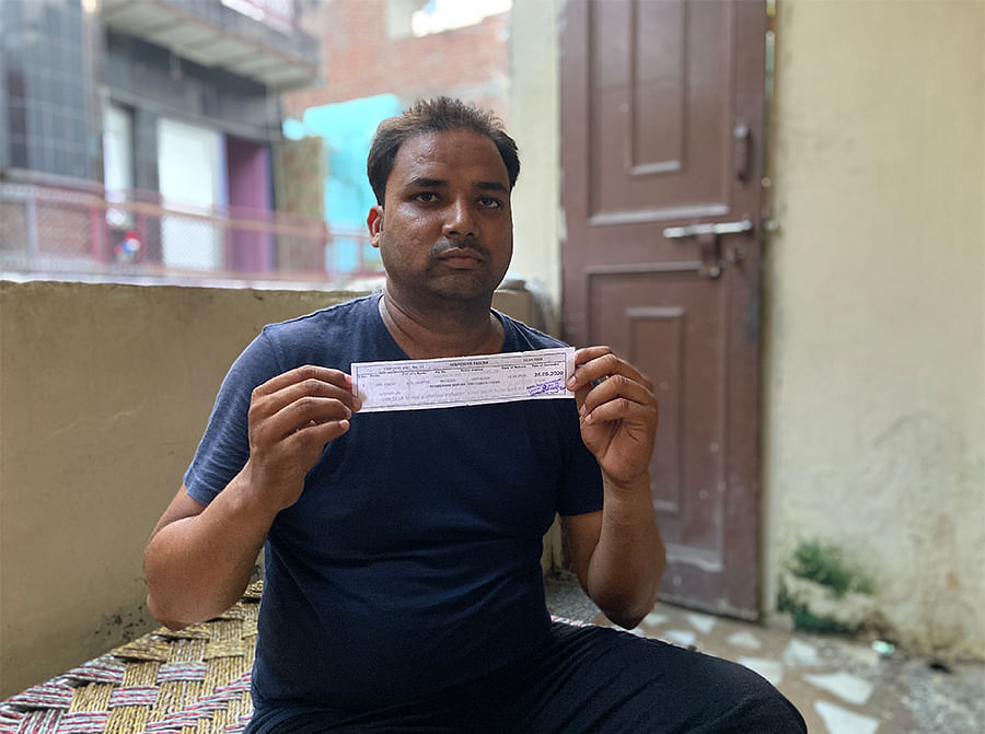 Mohammad Firoz, 28, with his bail slip.