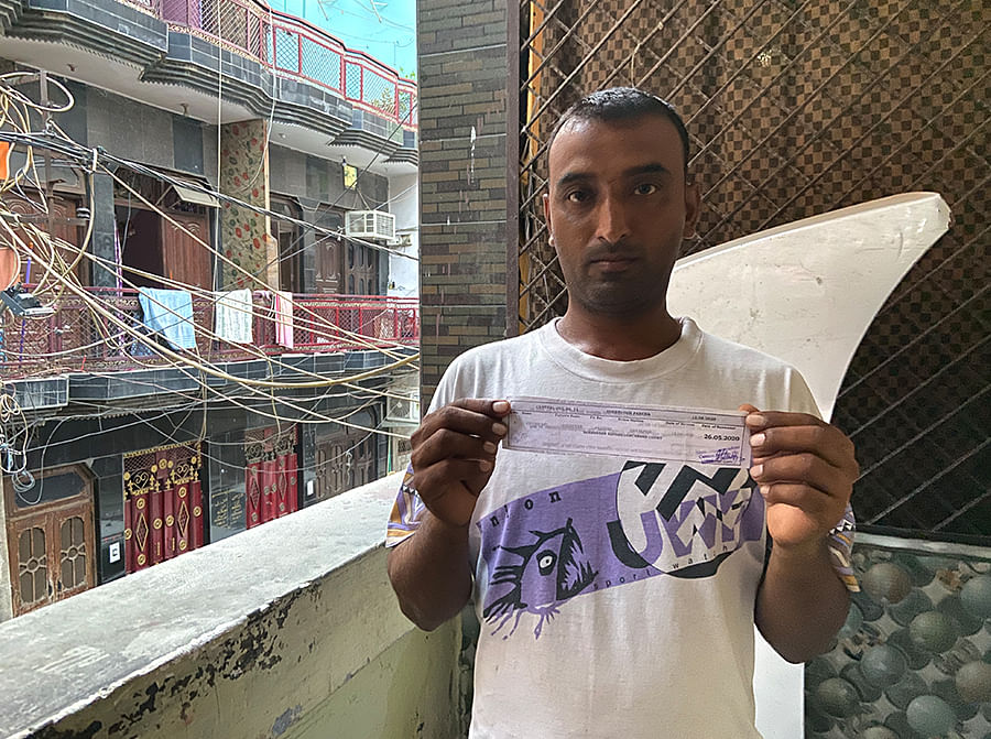 Chand Mohammad, 32, with his bail slip at his home in Chand Bagh in Northeast Delhi.
