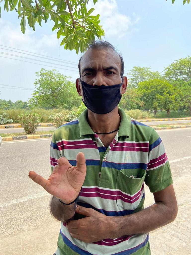 Mohan Singh's left hand.