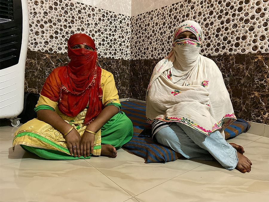 Shaheen, right, with a neighbour at her home in Subhash Mohalla, Ghonda.
