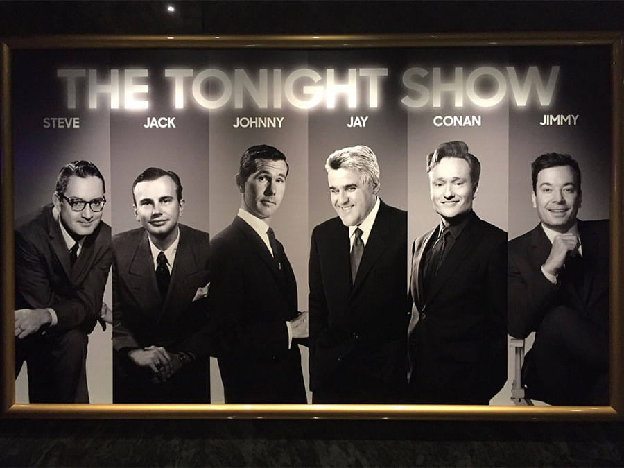 Past and present hosts of The Tonight Show on a wall at Universal Orlando which is owned by NBCUniversal. Johnny Carson changed the face of late-night television and inspired a generation of comedians.
