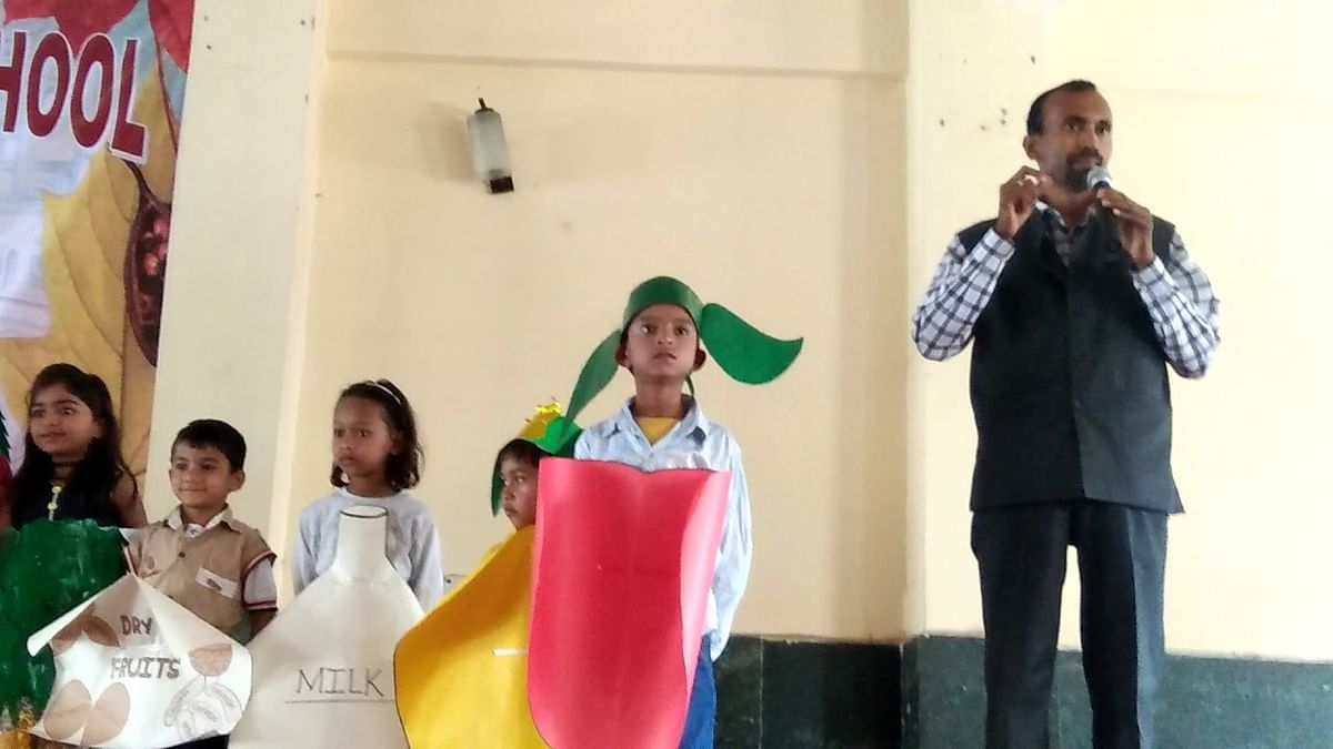 Chandrakant Singh speaking at an event of the school.
