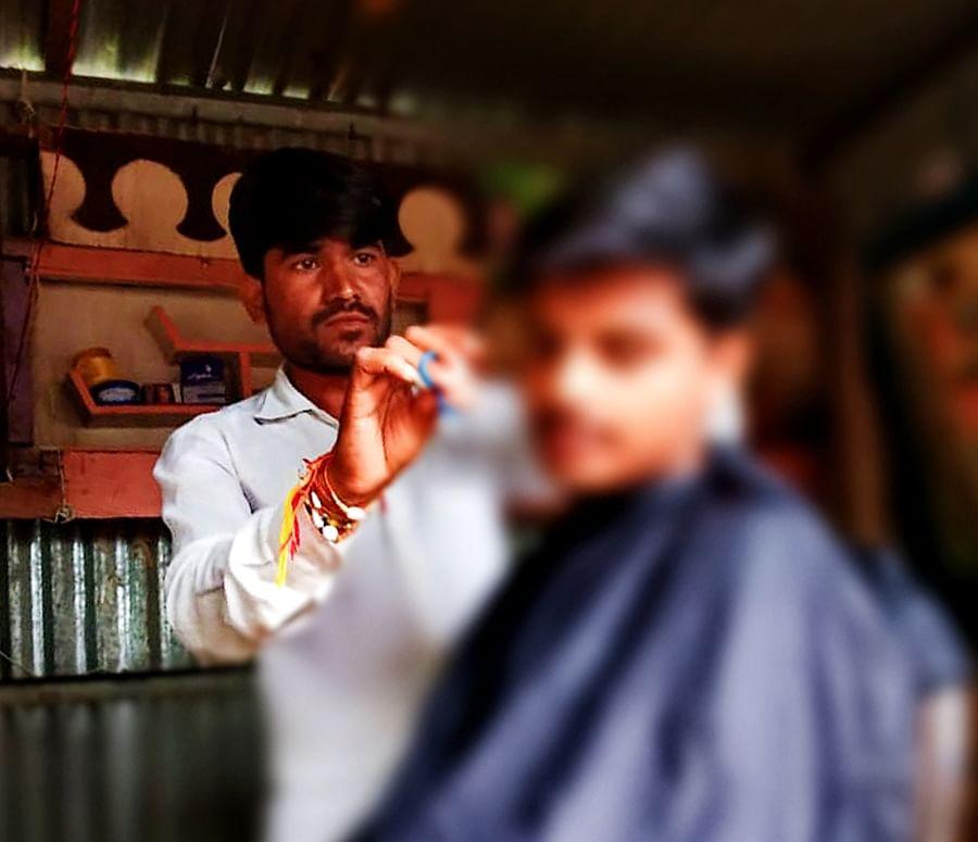 Rinku in Ramesh Sen's shop.