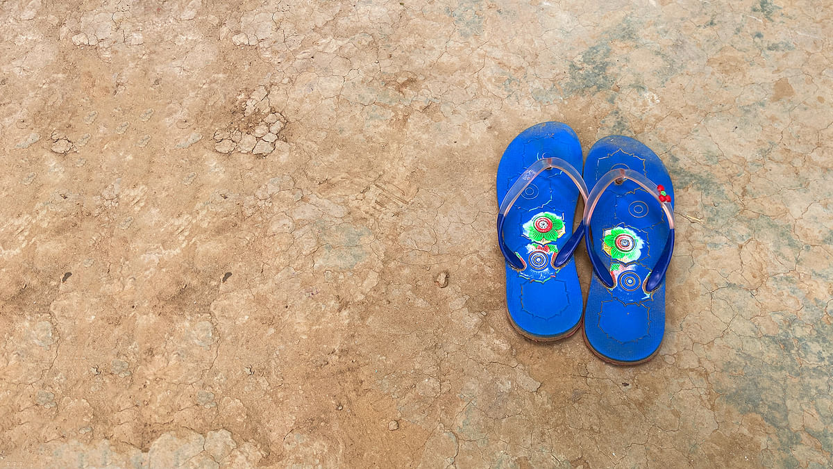 Asha's slippers led her mother to where she lay in the fields, naked, bleeding and barely alive.