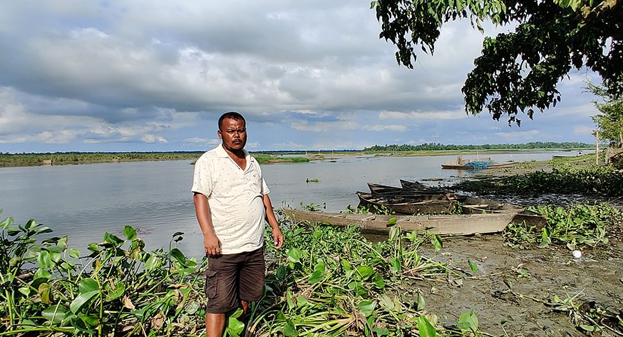 Bijoy Gohain stands infront of the Maguri beel, his boats and fishing nets have been abandoned for months.