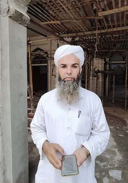 Mohammad Fakhruddin, 50, alleges the mosque and the madrassa were burned and looted by the police.