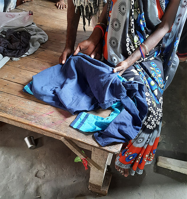 Shanti laying out her daughter's clothes.