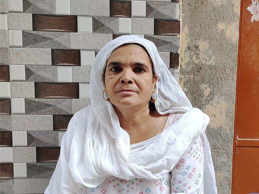 Arif's mother Parveen outside her home in Brijpuri.