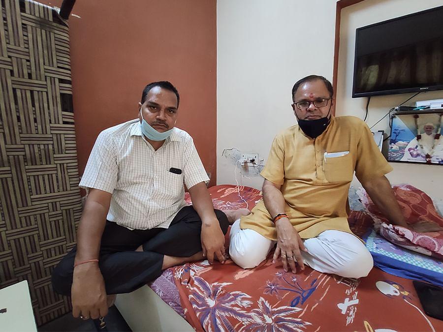 Ashok Solanki and Surendra Sharma at the latter's home in Brijpuri.