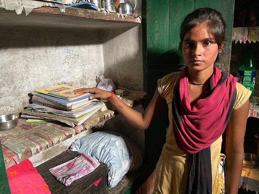 Sapna Devi shows her sister's books.