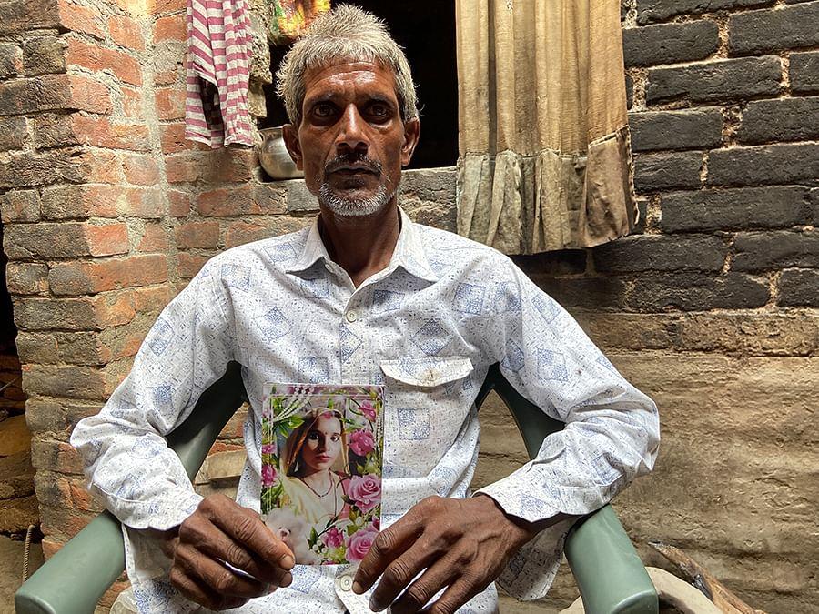 Sri Krishnan shows a picture of his daughter.