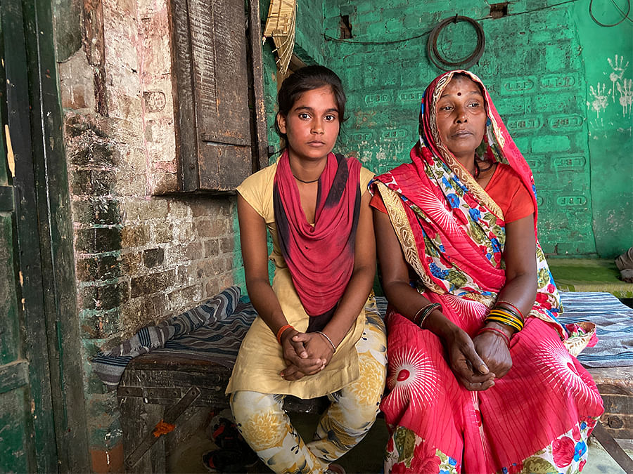 Pappi Devi's mother and sister at their home.