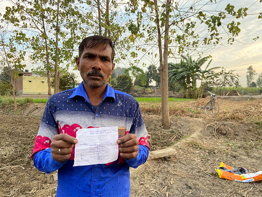 Vikram Singh shows the notice his family received.