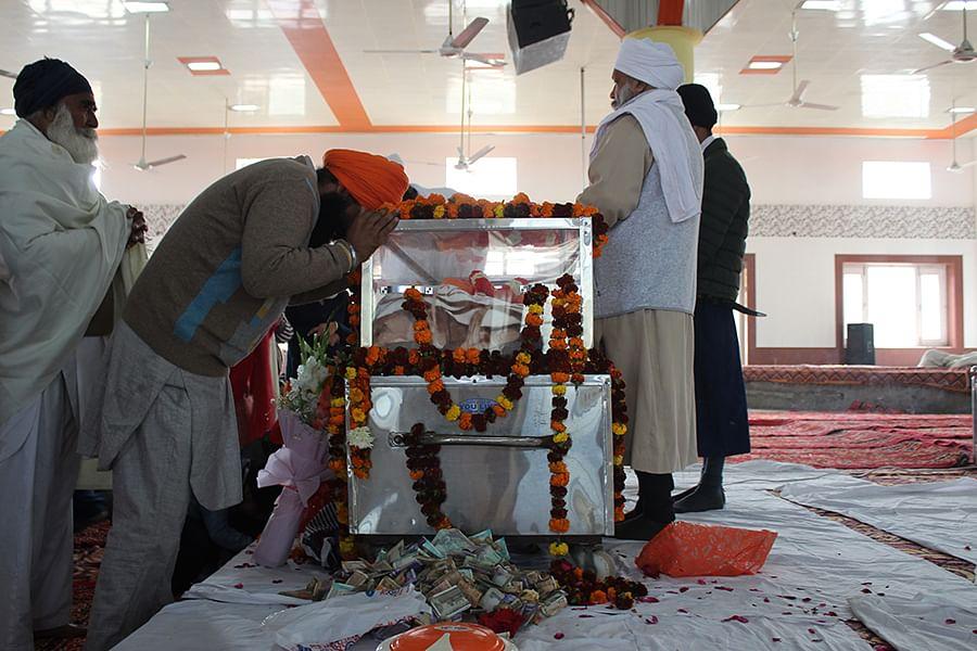 Devotees pay tribute to Baba Ram Singh at Nanaksar gurudwara.