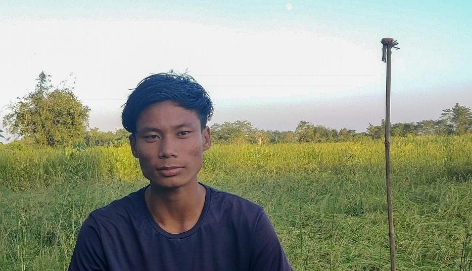 Janto Taik at his family's paddy field.