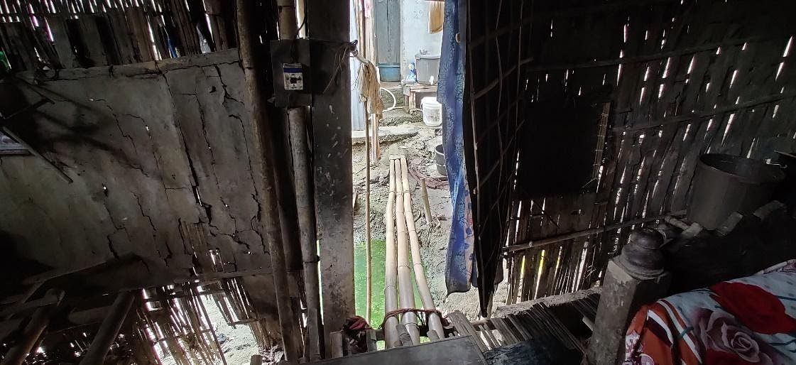 A makeshift bamboo bridge called dolong connects Lokhima Baruah's chang to the bathroom.