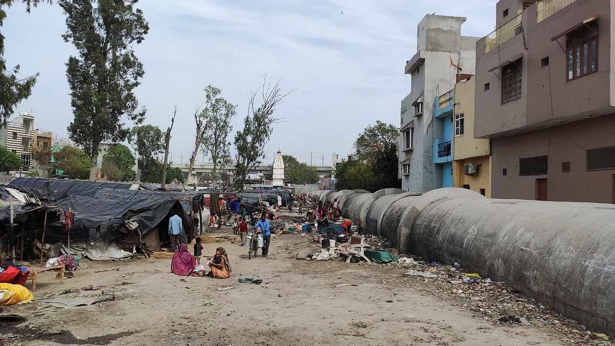 The slum in Gokulpuri on February 25, above, and March 12.