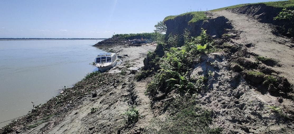 Signs of erosion are clearly visible along Jorhat Ghat, above, and Majuli.