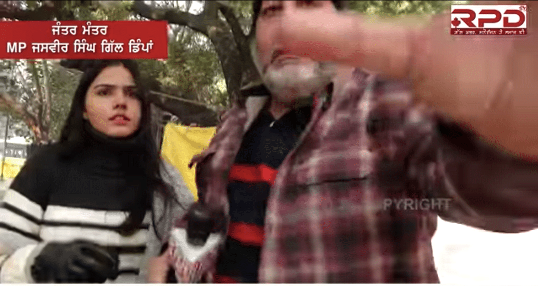 Gill snatches Kaur's mic and grabs the camera of the RPD 24 team at Jantar Mantar on Tuesday.
