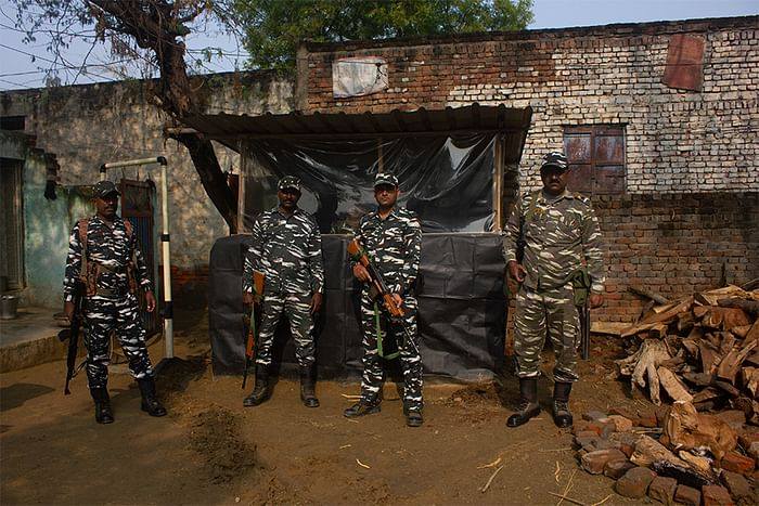 CRPF personnel and the metal detector.