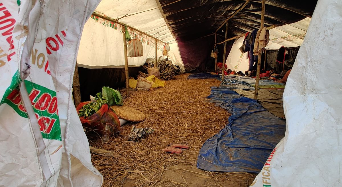 The tarpaulin tents are carpeted with dry hay.