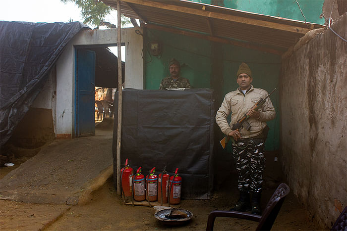 CRPF personnel outside Asha's home.