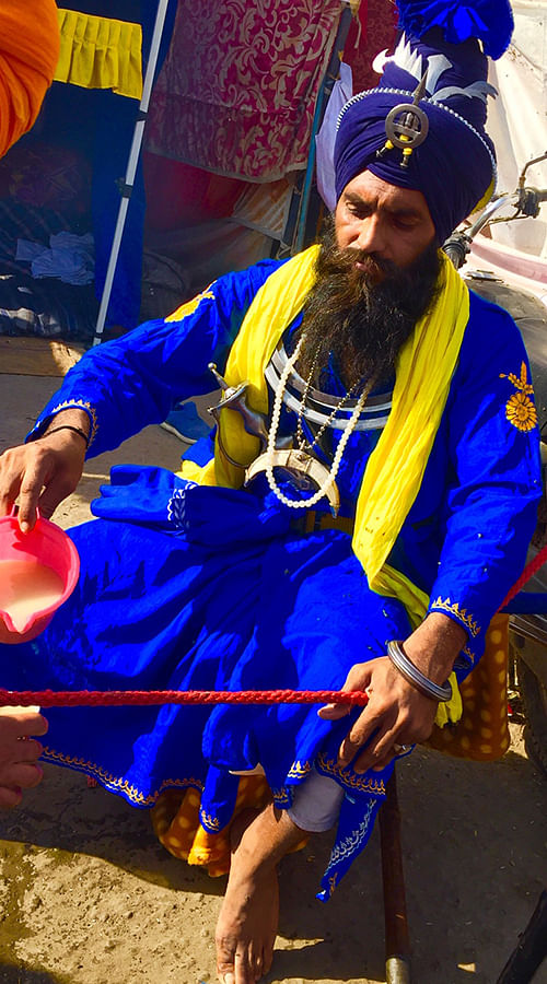 A Nihang Sikh from Bathinda serves sweet flavoured milk.
