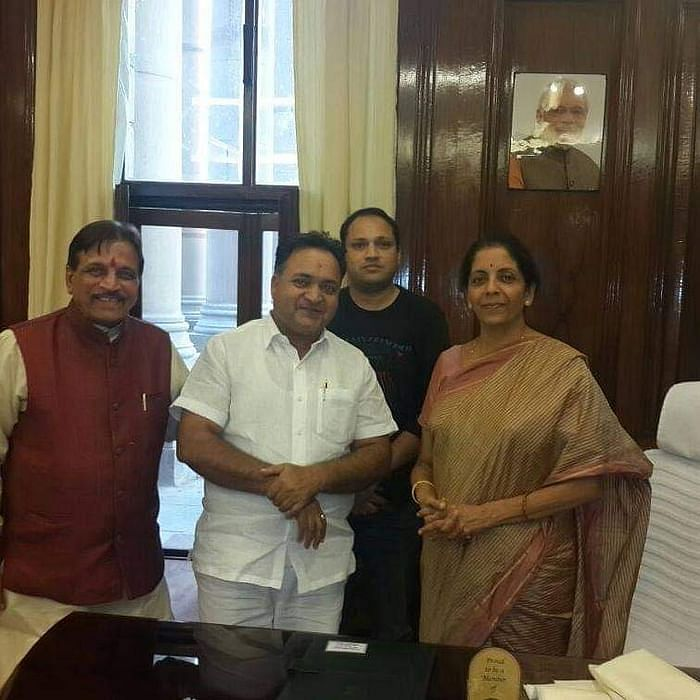 Bijendra Singh Dalal with Rajnath Singh, above, and Nirmala Sitharaman.