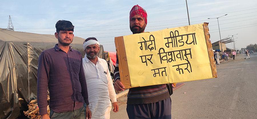 'Don't trust Godi Media,' reads this placard at Tikri.