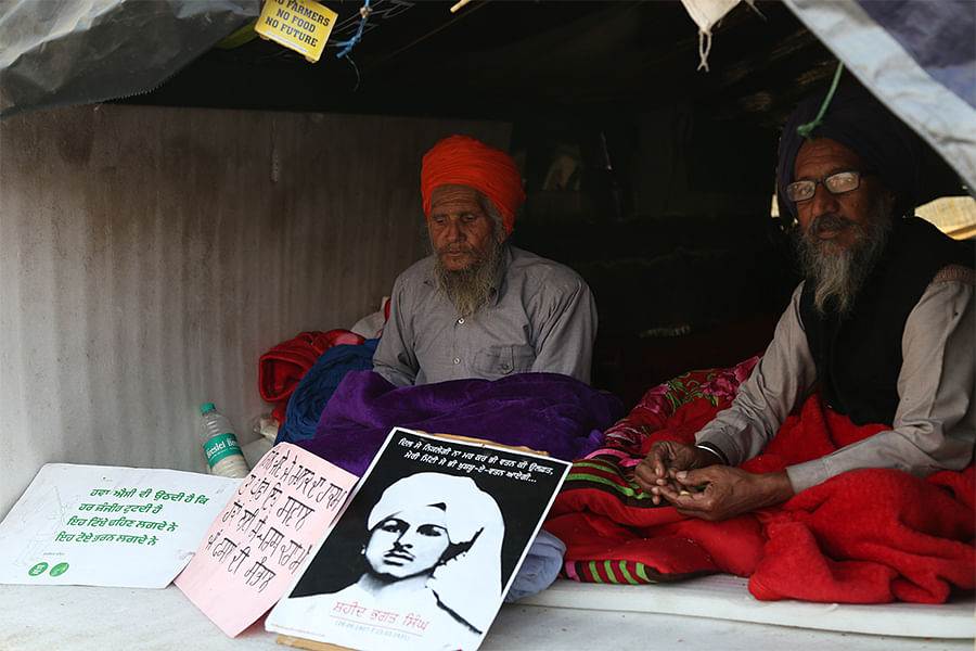 Protesters at Tikri with a poster of Bhagat Singh.