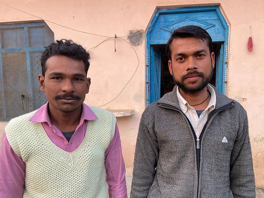 Parmesh Singh and fellow farmer Dharmendra Singh, 28, at Bijnor's Saini colony.