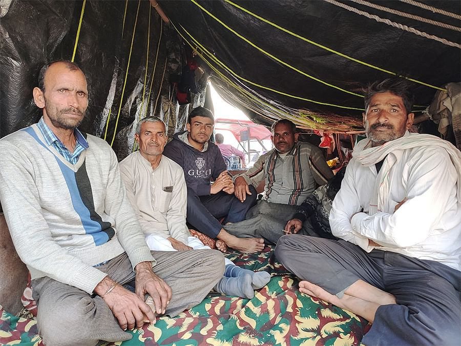 Yogendra Singh (extreme left), a farmer from Amroha, with fellow protesters at Ghazipur.