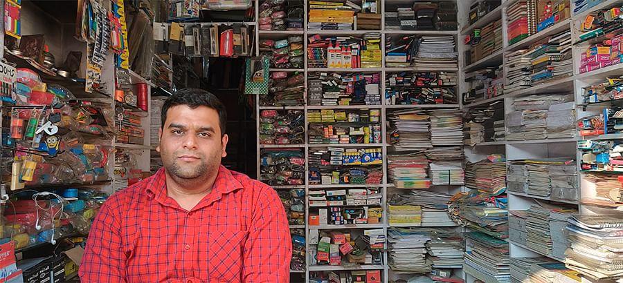 Achin Sachdeva, who runs a stationery shop.