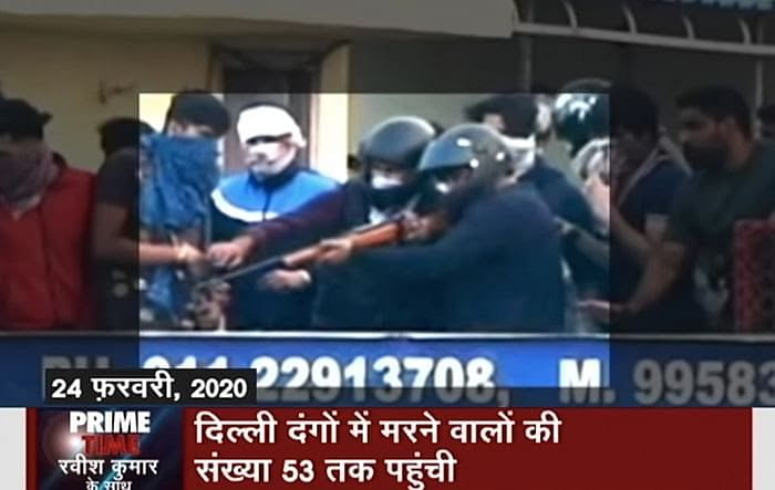 Gunman shooting at the Muslim mob from the terrace of Mohan Nursing Home. Courtesy: NDTV India