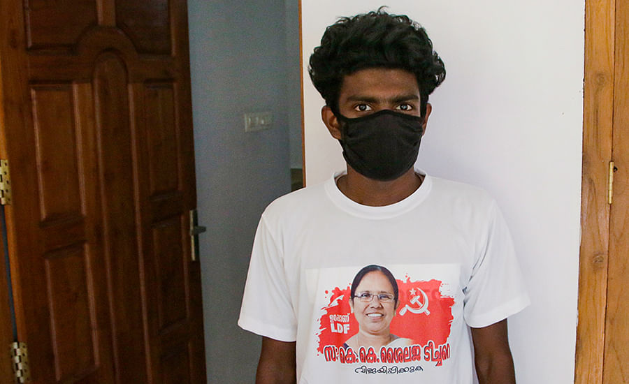 A supporter wearing a T-shirt with Shailaja's face on it.