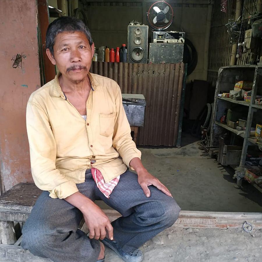 Trailokya Changmai, a vegetable seller from Santipur.
