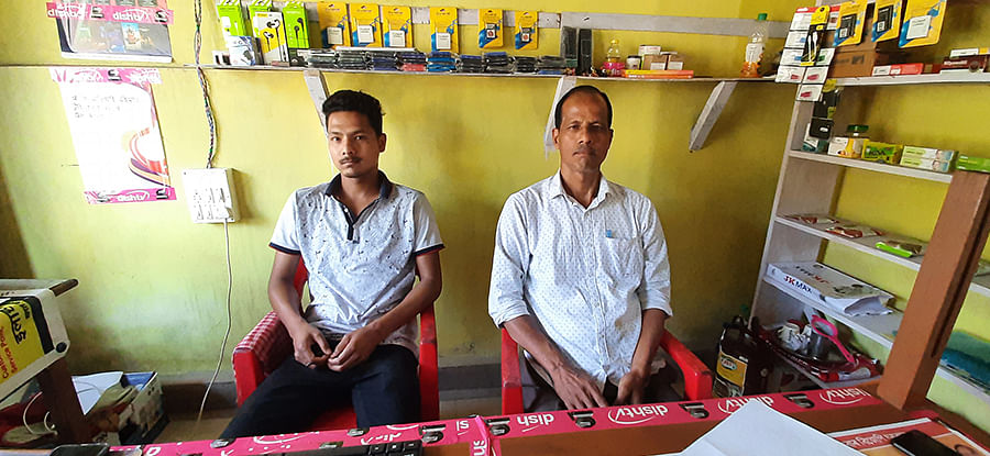Tirtha Saikia (left) with his father in Harabari Konwar gaon.