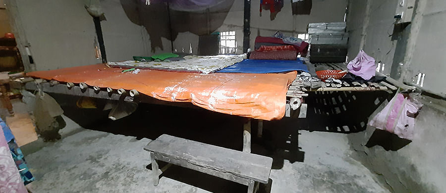 A saang, or makeshift raised platform, inside a home in Salmari.