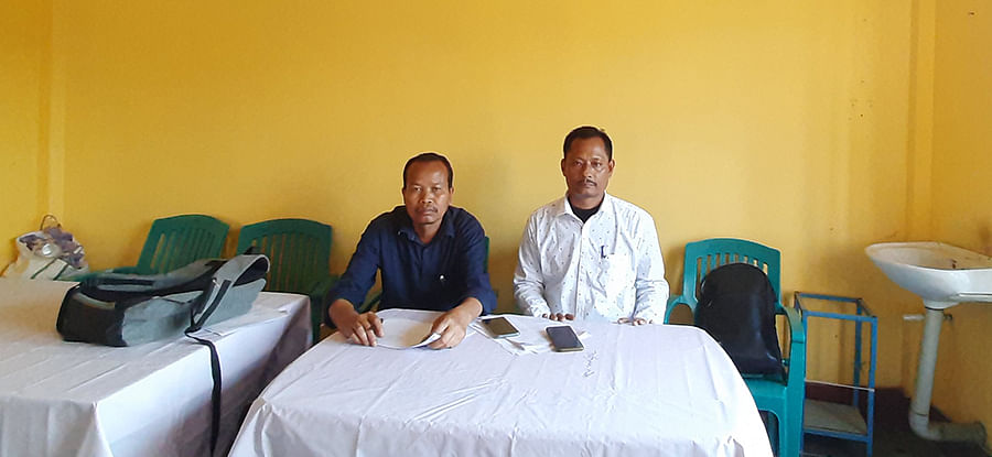 Prasanta Phukan (left) with a party colleague at the BJP office in Naharkatia.
