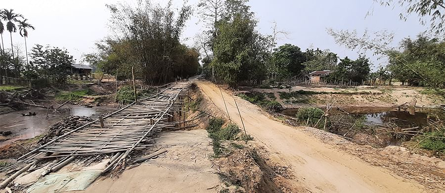 The road between Nalamukh and Tinigharia which has been damaged by floodwater.