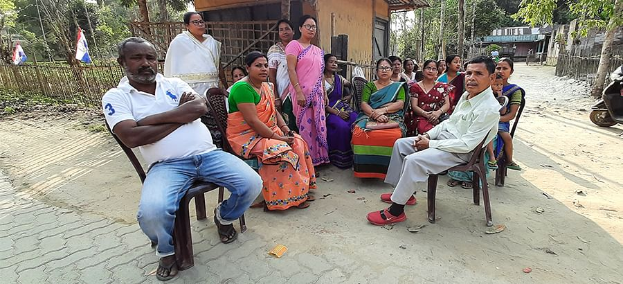 Supporters of the BJP alliance outside the Asom Gana Parishad office in Mudoi gaon.